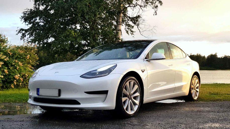 Tesla Model 3 in front of lake